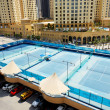 DUBAI, UAE - SEPTEMBER 12: The Tennis courts near a Walk at Jume — Stok fotoğraf