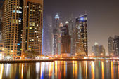 The night illumination at Dubai Marina and Cayan Tower, Dubai, — Stock Photo