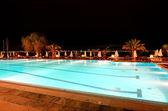 Swimming pool near beach in night illumination at the luxury hot — Stock Photo