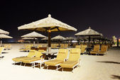 Beach night illumination with a view on Palm Jumeirah, Dubai, UA — Stock Photo