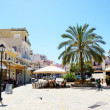 Stock Photo: KALAMATA, GREECE - JUNE 7: outdoor tavern with local inhabit