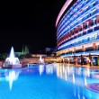 The swimming pool and building of luxury hotel in night illumina — Stock Photo #45586095