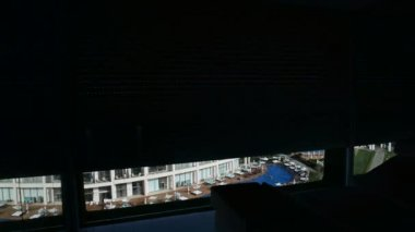The openning jalousie and view on luxury hotel from apartment, Antalya, Turkey — Stock Video
