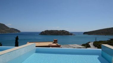 Swimming pool at luxury villa with view on Spinalonga island, Crete, Greece — Stock Video