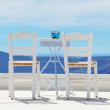 The chairs on the top of house, Santorini island, Greece — Stock Photo #47319417