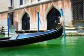 The gondola is on water channel, Venice, Italy — Stock Photo