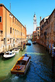 The water taxi with tourists is on water channel, Venice, Italy — Stock Photo