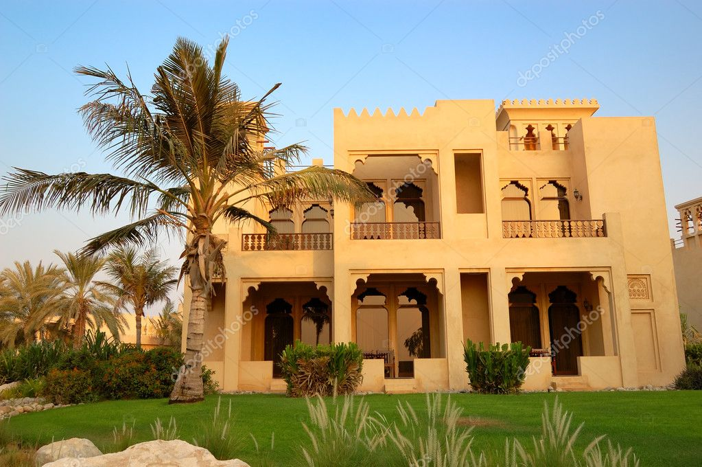 The arabic style villa and palm during sunset at luxury Style house fashion trading company uae