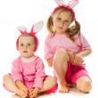 The little girl with pink ears bunny — Stock Photo #12731649
