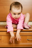 Little baby can not come down from a height — Stock Photo