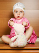 Little girl with plush toy. — Stock Photo