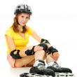 Beautiful young woman on roller skates — Stockfoto #12791114