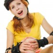 Beautiful young woman on roller skates — Stock Photo