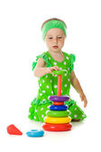Little girl is playing with toy pyramid — Stock Photo