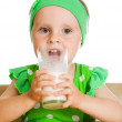 Cute little girl drinking milk from big glass — Stock Photo #12822299