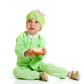 Cute baby eats the bread — Stock Photo