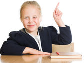Schoolgirl is sitting at his desk — Foto Stock