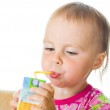Baby drinking juice from straw — Stock Photo #12831930