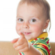 Kid with his finger pointing. — Stockfoto