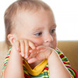 Cute baby thinking - Stock Photo