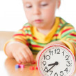 Little cute baby with clock - Stock Photo