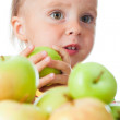 Baby eating apple - Foto Stock