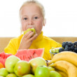 Girl eats fruit - Photo