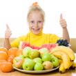 Girl eats fruit - Stock fotografie