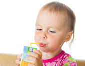 Baby drinking juice from straw — Stock Photo