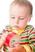 Little cute baby with clock — Stock Photo
