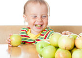 Baby eating apple — Stock Photo