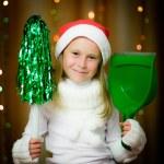 Smiling girl in santa hat — Stock Photo #13673984