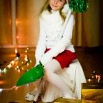 Smiling girl in santa hat — Stock Photo #13674030