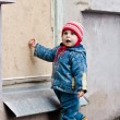 Baby knocks on the window. — Stock Photo