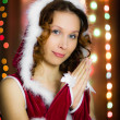 Christmas santa woman praying — Stockfoto