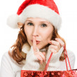 Beautiful Christmas woman showing silence gesture — Stock Photo #13683866