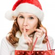 Stock Photo: Beautiful Christmas womshowing silence gesture