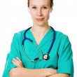Confident female doctor with his arms crossed — Stock Photo #14189136