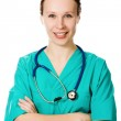 Confident female doctor with his arms crossed — Stock Photo #14189137