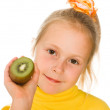 Cute girl with an kiwi in his hand — Stock Photo