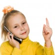 Young girl with mobile phone shows a finger up — Stock Photo #15278803