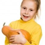 Cheerful girl hugs a pumpkin — Stock Photo #15282125