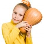 Cheerful girl hugs a pumpkin — Stock Photo