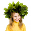 Royalty-Free Stock Photo: Little girl with green maple leaves on the head