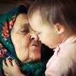 Very old grandmother with granddaughter — Stock Photo #15323849