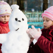 Happy two child with snowman — Stock Photo #15329213