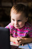 Cute kid with a laptop. — Stock Photo