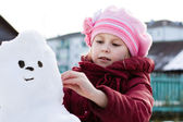 Happy child with snowman — Stok fotoğraf