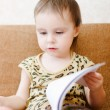 Beautiful cute baby reading a book — Stock Photo #16043597