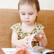 Beautiful cute baby reading a book — Stock Photo #16043605